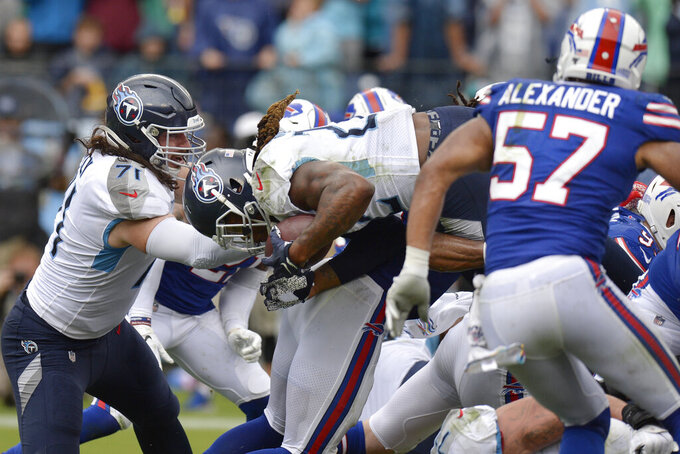 Tennessee Titans running back Derrick Henry, center, dives over the goal line on a 1-yard run for a touchdown against the Buffalo Bills in the second half of an NFL football game Sunday, Oct. 6, 2019, in Nashville, Tenn. (AP Photo/Mark Zaleski)