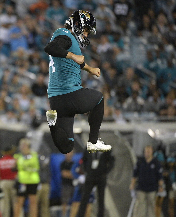 Jacksonville Jaguars kicker Josh Lambo leaps igh into the air after his 48-yard field goal against the Tennessee Titans during the second half of an NFL football game Thursday, Sept. 19, 2019, in Jacksonville, Fla. (AP Photo/Phelan Ebenhack)