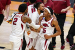 Arkansas forward Vance Jackson (2) and Arkansas guard Moses Moody (5) celebrate after a 68-66 win over Texas Tech in a second-round game in the NCAA men's college basketball tournament at Hinkle Fieldhouse in Indianapolis, Sunday, March 21, 2021. (AP Photo/Michael Conroy)