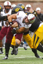 Troy quarterback Kaleb Barker is tackled by Missouri defensive lineman Kobie Whiteside during the first half of an NCAA college football game Saturday, Oct. 5, 2019, in Columbia, Mo. (AP Photo/L.G. Patterson)