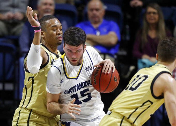 Chattanooga forward Ramon Vila (15) works for a shot against Wofford forward Cameron Jackson, left, during the first half of an NCAA college basketball game Thursday, Feb. 28, 2019, in Chattanooga, Tenn. (AP photo/Wade Payne)