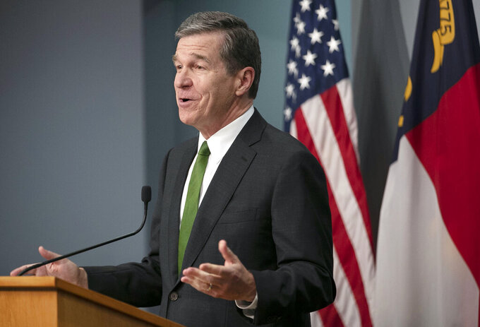 North Carolina Gov. Roy Cooper announces a cash drawing incentive along with college scholarships to boost COVID-19 vaccination rates, during a news briefing on Thursday, June 10, 2021 at the Emergency Operations Center in Raleigh, N.C. (Robert Willett/The News & Observer via AP)