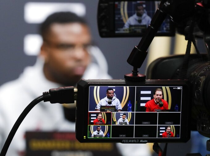 Alabama's Damien Harris answers questions during media day for the NCAA college football playoff championship game Saturday, Jan. 5, 2019, in Santa Clara, Calif. (AP Photo/Chris Carlson)
