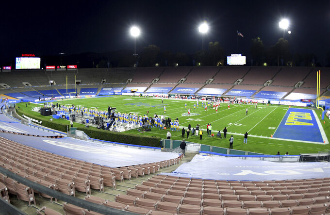 UCLA takes on Arizona in a stadium empty of fans due to the coronavirus pandemic, at an NCAA college football game Saturday, Nov. 28, 2020, in Pasadena, Calif. (Keith Birmingham/The Orange County Register via AP)