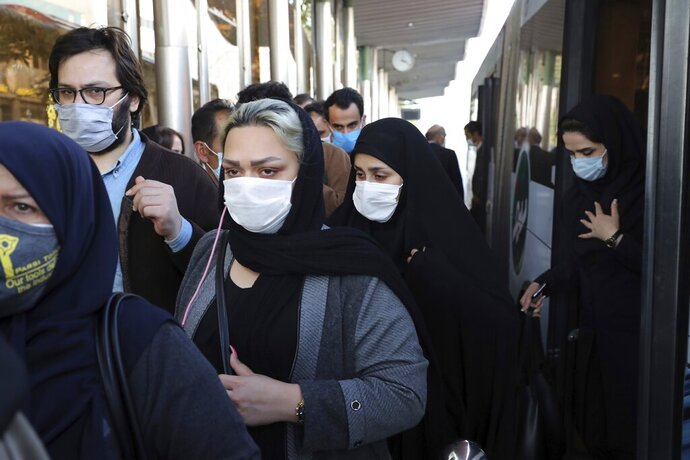 FILE - In this Sunday, Oct. 11, 2020 file photo, people wear protective face masks to help prevent the spread of the coronavirus in downtown Tehran, Iran. For the second day in a row, Iran announced Monday its highest single-day death toll from the coronavirus with 272 people killed. The announcement by Health Ministry spokeswoman Sima Sadat Lari saw Iran also give its single-day highest count of new cases with 4,206 new patients.(AP Photo/Ebrahim Noroozi, File)
