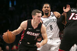 Miami Heat guard Goran Dragic (7) drives around Brooklyn Nets guard Spencer Dinwiddie (8) in the first half of a basketball game, Sunday, Dec. 1, 2019 in New York. (AP Photo/Mark Lennihan)