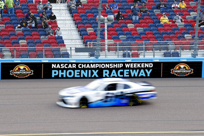 A car races through Turn 4 during the NASCAR Xfinity Series auto race at Phoenix Raceway, Saturday, Nov. 7, 2020, in Avondale, Ariz. (AP Photo/Ralph Freso)