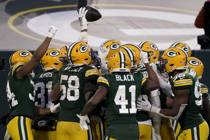 Green Bay Packers' Jaire Alexander (23) celebrates after intercepting a pass intended for Tampa Bay Buccaneers' Mike Evans during the second half of the NFC championship NFL football game in Green Bay, Wis., Sunday, Jan. 24, 2021. (AP Photo/Morry Gash)