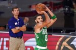 Boston Celtics forward Jayson Tatum (0) attempts a shot as head coach Brad Stevens, left rear, looks on during the second half of Game 4 of an NBA basketball Eastern Conference final against the Miami Heat on Wednesday, Sept. 23, 2020, in Lake Buena Vista, Fla. (AP Photo/Mark J. Terrill)
