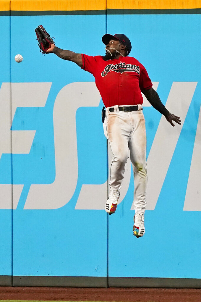 Cleveland Indians' Daniel Johnson jumps but can't get to a triple hit by Tampa Bay Rays' Francisco Mejia during the seventh inning of a baseball game Thursday, July 22, 2021, in Cleveland. (AP Photo/Tony Dejak)