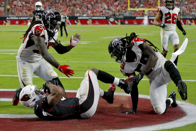 Arizona Cardinals running back David Johnson (31) scores a touchdown as Atlanta Falcons outside linebacker De'Vondre Campbell (59) defends during the second half of an NFL football game, Sunday, Oct. 13, 2019, in Glendale, Ariz. (AP Photo/Rick Scuteri)