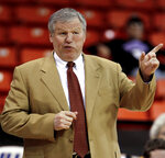 FILE - Kennesaw coach Tony Ingle has some words for his players during the first half of an NCAA college basketball game at the Chicago Invitational Challenge, in Chicago, in this Friday, Nov. 27, 2009, file photo. Tony Ingle, who failed to win a game in his tenure as BYU's interim basketball coach but went on to capture lower-division national championships at two Georgia colleges, has died at the age of 68. His son, Izzy, announced on Twitter that Ingle died Monday night, Jan. 18, 2021, of complications from COVID-19. (AP Photo/John Smierciak, File)