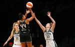 New York Liberty's Betnijah Laney (44) shoots over Seattle Storm's Katie Lou Samuelson (33) during the first half of a WNBA basketball game Friday, Aug. 20, 2021, in New York. (AP Photo/Noah K. Murray)