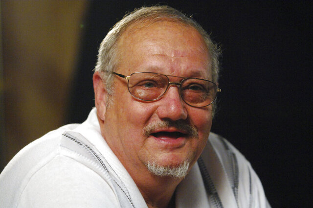 In this Aug. 30, 2007 photo Jack Whittaker speaks during an interview in Mount Hope, W.Va. Whittaker Jr., whose life became rife with setbacks and tragedy after winning a record $315 Powerball jackpot on Christmas night in 2002, has died. He was 72. On Tuesday, June 30, 2020, Ronald Meadows Funeral Parlor in Hinton, West Virginia confirmed Whittaker's death. (AP Photo/Jeff Gentner)