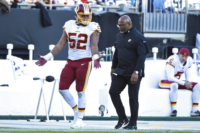 Washington Redskins linebacker Ryan Anderson (52) leaves the field after being disqualified for a hit on Carolina Panthers tight end Greg Olsen (88) during the second half of an NFL football game in Charlotte, N.C., Sunday, Dec. 1, 2019. (AP Photo/Mike McCarn)