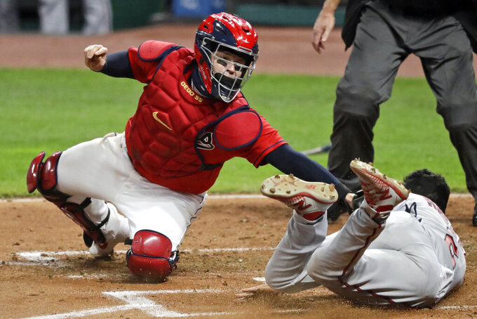 FILE - In this Aug. 24, 2020, file photo, Minnesota Twins' Luis Arraez, right, is tagged out by Cleveland Indians' Roberto Perez in the fifth inning in a baseball game in Cleveland. The Indians will exercise the $5.5 million contract in 2021 for catcher Roberto Perez, who has been exemplary in handling one of the AL's best pitching staffs. (AP Photo/Tony Dejak, File)