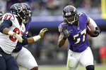 Baltimore Ravens middle linebacker Josh Bynes (57) runs with the ball as Houston Texans tight end Darren Fells (87) tries to stop him after Bynes intercepted a pass from Texans quarterback Deshaun Watson, not visible, during the second half of an NFL football game, Sunday, Nov. 17, 2019, in Baltimore. (AP Photo/Nick Wass)