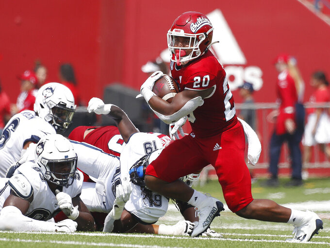 Fresno State running back Ronnie Rivers (20) looks for room to run against Connecticut during the first half of an NCAA college football game in Fresno, Calif., Saturday, Aug. 28, 2021. (AP Photo/Gary Kazanjian)