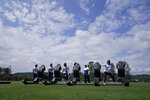 Seattle Seahawks', from left, Cody Barton (57), K.J. Wright (50), Neiko Thorpe (23), Shaquill Griffin, and Tre Flowers (21) stay distanced as they hit a blocking sled during NFL football training camp, Wednesday, Aug. 12, 2020, in Renton, Wash. (AP Photo/Ted S. Warren, Pool)