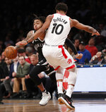 Brooklyn Nets guard D'Angelo Russell (1) collies with Toronto Raptors guard DeMar DeRozan (10) as he drives to the basket during the second half of an NBA basketball game, Tuesday, March 13, 2018, in New York. The Raptors defeated the Nets 116-102. (AP Photo/Kathy Willens)