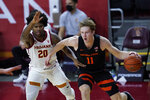 Southern California guard Ethan Anderson (20) defends against Oregon State guard Zach Reichle (11) during the first half of an NCAA college basketball game Thursday, Jan. 28, 2021, in Los Angeles. (AP Photo/Ashley Landis)
