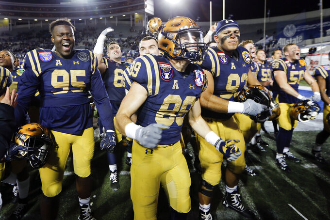 Navy players celebrate after beating Kansas State in the Liberty Bowl NCAA college football game Tuesday, Dec. 31, 2019, in Memphis, Tenn. Navy won 20-17. (AP Photo/Mark Humphrey)