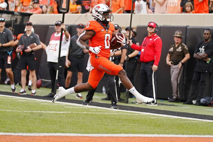 Oklahoma State running back LD Brown (0) runs into the end zone for a touchdown in the first half of an NCAA college football game against Missouri State, Saturday, Sept. 4, 2021, in Stillwater, Okla. (AP Photo/Sue Ogrocki)