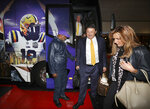 LSU head coach Ed Orgeron and his wife Kelly arrive with the team for the CFP Peach Bowl on Sunday, Dec. 22, 2019, in Atlanta. (Curtis Compton/Atlanta Journal-Constitution via AP)