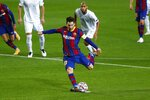 Barcelona's Lionel Messi scores a penalty during the Champions League group G soccer match between FC Barcelona and Ferencvaros at the Camp Nou stadium in Barcelona, Spain, Tuesday, Oct. 20, 2020. (AP Photo/Joan Monfort)