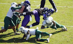 TCU running back Sewo Olonilua (33) is tackled by Baylor safety Will Williams (33) during the first half of an NCAA college football game, Saturday, Nov. 9, 2019, in Fort Worth, Texas. (AP Photo/Ron Jenkins)