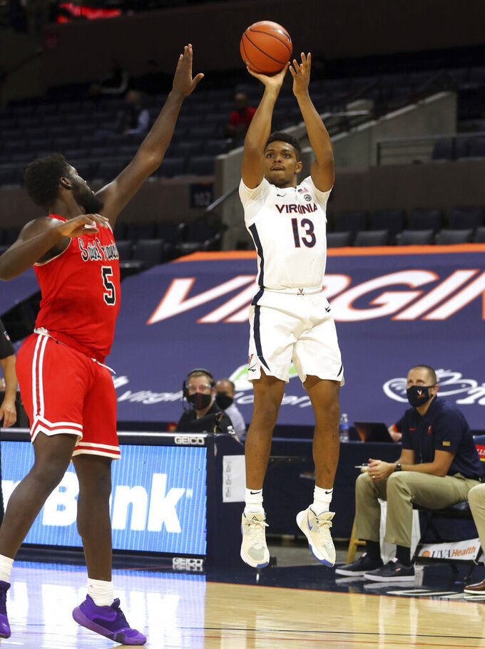 Virginia guard Casey Morsell (13) shoots over St. Francis forward Myles Thompson (5) during an NCAA college basketball game Tuesday, Dec. 1, 2020, in Charlottesville, Va. (Andrew Shurtleff/The Daily Progress via AP)