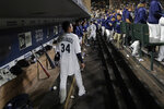 Seattle Mariners starting pitcher Felix Hernandez stands in the dugout after he was pulled from the team's baseball game against the Oakland Athletics during the sixth inning Thursday, Sept. 26, 2019, in Seattle in his final start of the season. (AP Photo/Ted S. Warren)