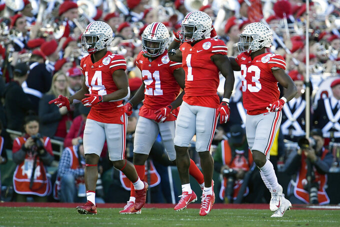 Ohio State wide receiver Johnnie Dixon (1) celebrates after scoring against Washington during the first half of the Rose Bowl NCAA college football game Tuesday, Jan. 1, 2019, in Pasadena, Calif. (AP Photo/Mark J. Terrill)