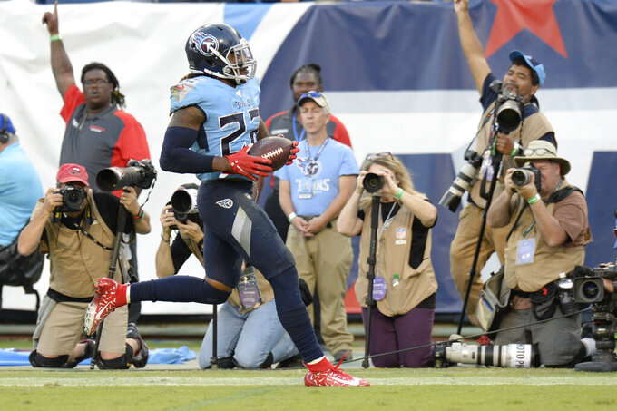 Tennessee Titans running back Derrick Henry scores a touchdown on an 11-yard run against the Los Angeles Chargers in the second half of an NFL football game Sunday, Oct. 20, 2019, in Nashville, Tenn. (AP Photo/Mark Zaleski)