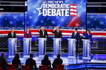 FILE - In this Feb. 19, 2020, file photo, from left, Democratic presidential candidates, former New York City Mayor Mike Bloomberg, Sen. Elizabeth Warren, D-Mass., Sen. Bernie Sanders, I-Vt., former Vice President Joe Biden, former South Bend Mayor Pete Buttigieg, Sen. Amy Klobuchar, D-Minn., participate in a Democratic presidential primary debate Wednesday, in Las Vegas, hosted by NBC News and MSNBC. The Democratic presidential contest has moved to immigrant-heavy Nevada, but the issues of immigration are seldom getting a thorough airing on the campaign trail. Candidates usually throw in a quick condemnation of President Donald Trump's hard-line policies but have shied away from outlining their own immigration positions. Immigration groups say that points to a potential vulnerability for whoever is the Democratic nominee later this year. (AP Photo/John Locher, File)