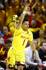 Maryland guard Anthony Cowan Jr. gestures after making a three-point basket in the first half of an NCAA college basketball game against Minnesota, Friday, March 8, 2019, in College Park, Md. (AP Photo/Patrick Semansky)
