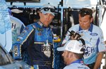 Kevin Harvick talks to his crew after a practice session for the NASCAR cup series race at Michigan International Speedway, Friday, June 7, 2019, in Brooklyn, Mich. (AP Photo/Carlos Osorio)
