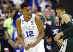 Duke forward Javin DeLaurier (12) reacts to scoring against Michigan State during the second half of an NCAA men's East Regional final college basketball game in Washington, Sunday, March 31, 2019. (AP Photo/Patrick Semansky)