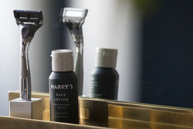 FILE - In this June 15, 2018, file photo, the Winston razor and Harry's face lotion are on display at the headquarters of Harry's Inc., in New York. Federal antitrust regulators say a proposed merger that would combine old-school shaving company Schick with upstart Harry's would end up costing consumers some skin. (AP Photo/Mary Altaffer, File)