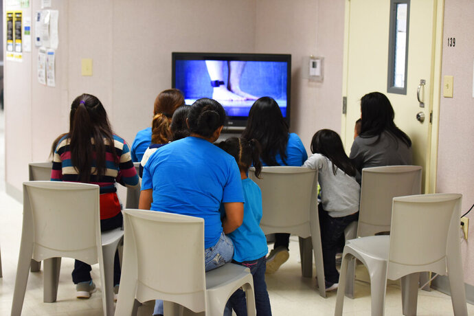 FILE - This Aug. 9, 2018, file photo, provided by U.S. Immigration and Customs Enforcement, shows a scene from a tour of South Texas Family Residential Center in Dilley, Texas. Months after the Trump administration ended the general policy of separating parents and children, advocates and members of Congress are questioning the treatment of children who cross the U.S.-Mexico border with other relatives - grandparents, uncles and aunts, and adult siblings. (Charles Reed/U.S. Immigration and Customs Enforcement via AP, File)