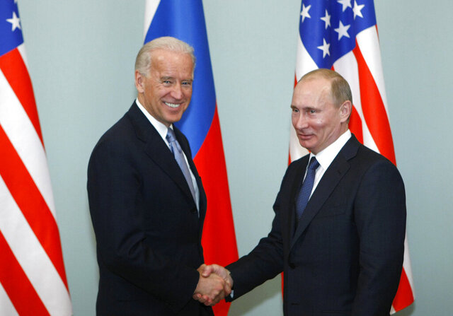 FILE - In this March 10, 2011, file photo, then-Vice President Joe Biden, left, shakes hands with Russian Prime Minister Vladimir Putin in Moscow, Russia.  President Joe Biden has been thrown into a high-wire act with Russia as he seeks to toughen his administration's stance against Putin while preserving room for diplomacy in a post-Donald Trump era. (AP Photo/Alexander Zemlianichenko, File)