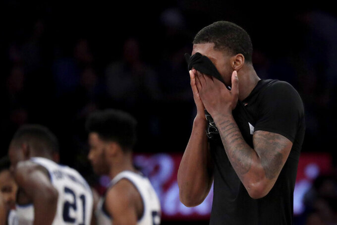 Xavier forward Naji Marshall reacts after fouling out against Villanova during overtime of an NCAA college basketball semifinal game in the Big East men's tournament, Friday, March 15, 2019, in New York. Villanova won 71-67 in overtime. (AP Photo/Julio Cortez)