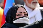 A woman takes part in a protest in Tahrir Square, Baghdad, Iraq, Thursday, Feb. 13, 2020. Hundreds of women took to the streets of central Baghdad and southern Iraq on Thursday in defiance of a radical cleric's calls for gender segregation in anti-government protest sites. Iraqis began protesting on Oct. 1 to decry rampant government corruption, poor services and unemployment. The protests have been unique because they have drawn both men and women who have camped out alongside each other in protest squares, a rare occurrence in Iraq. (AP Photo/Khalid Mohammed)