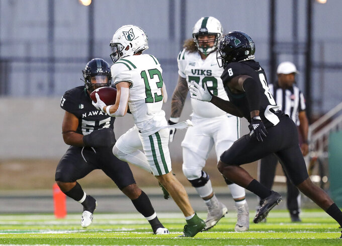 Portland State wide receiver Beau Kelly (13) makes a catch between Hawaii's Darius Muasau (53) and Eugene Ford (8) during the first half of an NCAA college football game, Saturday, Sept. 4, 2021, in Honolulu. (AP Photo/Darryl Oumi)