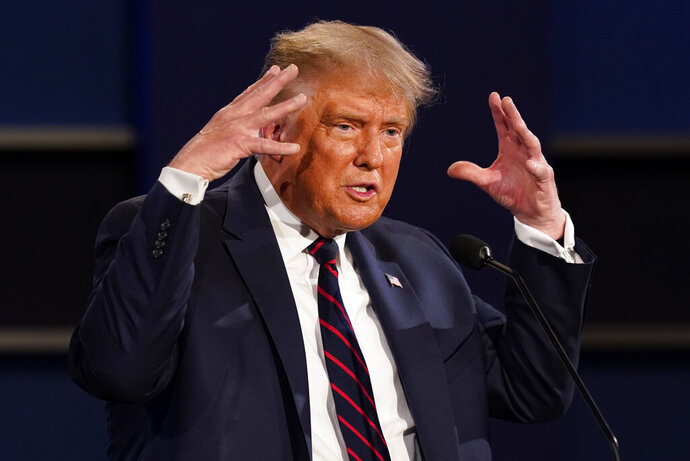 President Donald Trump gestures while speaking during the first presidential debate Tuesday, Sept. 29, 2020, at Case Western University and Cleveland Clinic, in Cleveland, Ohio. (AP Photo/Patrick Semansky)