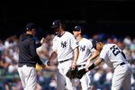 New York Yankees starting pitcher Gerrit Cole, center, is relieved in the sixth inning of a baseball game against the Cleveland Indians, Sunday, Sept. 19, 2021, in New York. (AP Photo/Eduardo Munoz Alvarez)