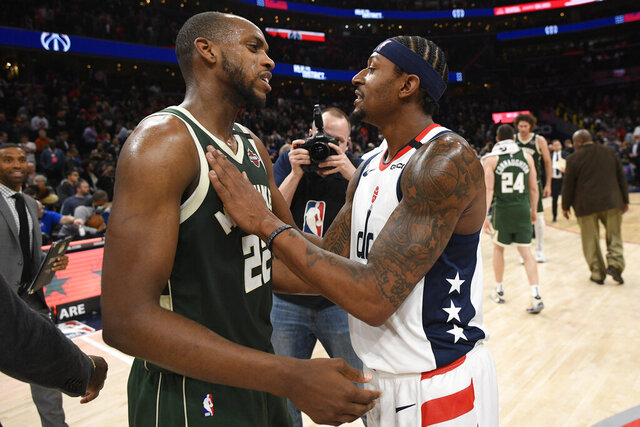 Washington Wizards guard Bradley Beal, right, meets with Milwaukee Bucks forward Khris Middleton (22) after an NBA basketball game, Monday, Feb. 24, 2020, in Washington. (AP Photo/Nick Wass)