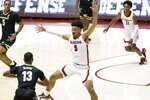 Alabama guard Jaden Shackelford (5) defends against Vanderbilt guard Issac McBride (13) during the first half of an NCAA basketball game on Saturday, Feb. 20, 2021, in Tuscaloosa, Ala. (AP Photo/Vasha Hunt)