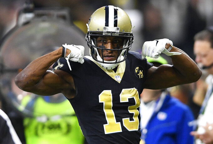 New Orleans Saints wide receiver Michael Thomas (13) celebrates a run against the Philadelphia Eagles in the first half of an NFL divisional playoff football game in New Orleans, Sunday, Jan. 13, 2019. (AP Photo/Bill Feig)