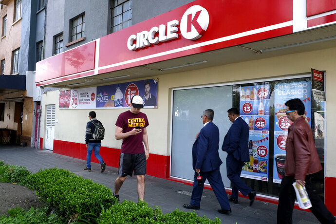 People walk past a Circle K convenience store in Mexico City, Thursday, July 18, 2019. Circle K Mexico is apologizing for an ad on